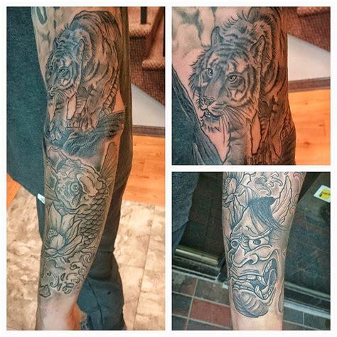 level up tattoo japanese tiger fish blackwork level up