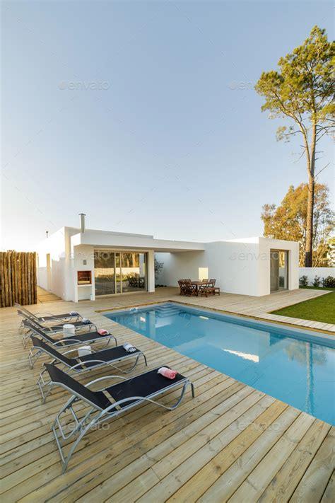 modern house  garden swimming pool  wooden deck
