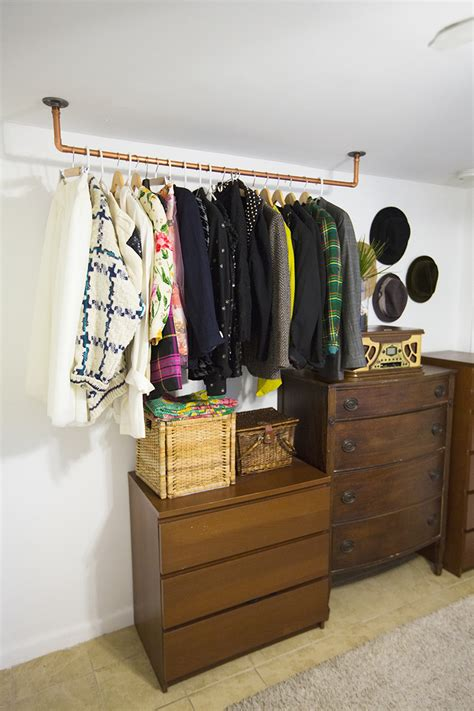 diy clothes storage hanging copper pipe clothing rack diy a beautiful mess