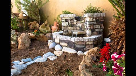 como hacer una fuente de jardin decorando el jardin con fuente de agua