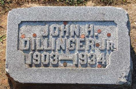why is dillinger s grave covered in 4 layers of