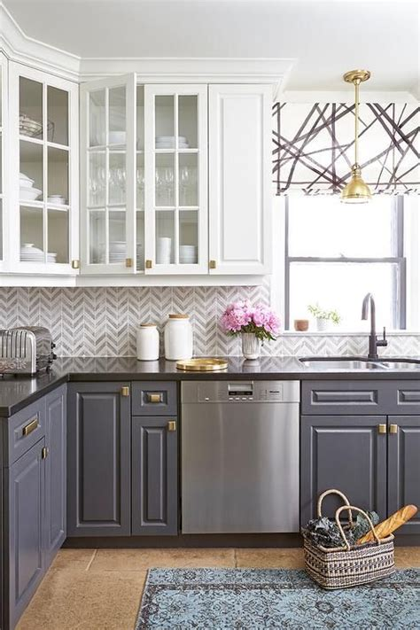 Grey Kitchen Cabinets With Black Countertops by Stunning Kitchen Features White Cabinets And Gray