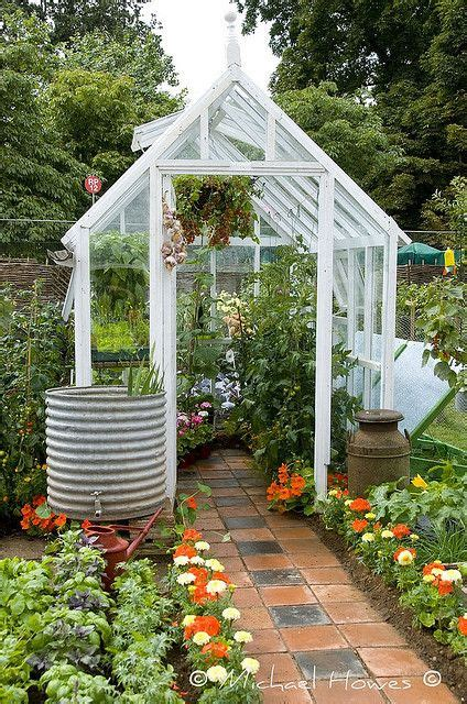 small backyard greenhouses greenhouse in the backyard i want the rain barrel with
