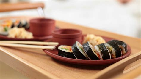 japanese bed roll japanese bed roll serve a tray of sushi stock footage video 2838310