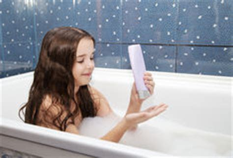 how to get hair out of a bathtub drain mom pours a little girl out of the shower stock photo