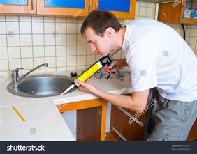 Sealant For Kitchen Sink Plumber Putting Silicone Sealant Installing Kitchen Stock Photo 82709977