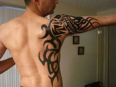 tribal tattoos arm and shoulder celtic cross tribal on arm