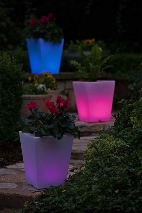 Illuminated Garden Planters by Illuminated Planters For A Look Of The Backyard