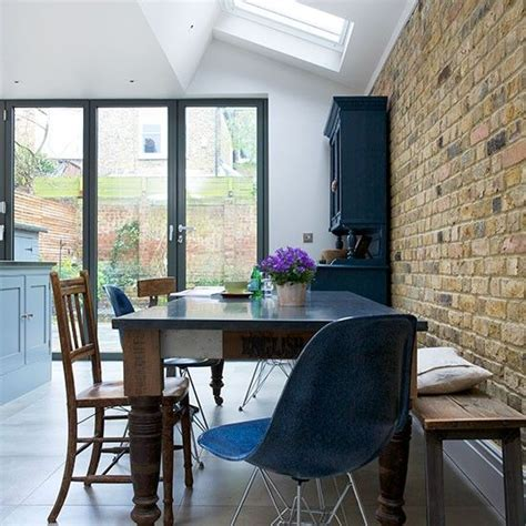 dining room with exposed brick wall kitchens