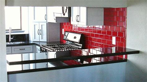 red backsplash tiles kitchen cabinet pink granite red subway tile white cabinets black counters kitchen