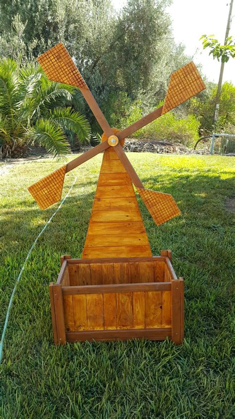 wooden windmill planter   diy garden furniture