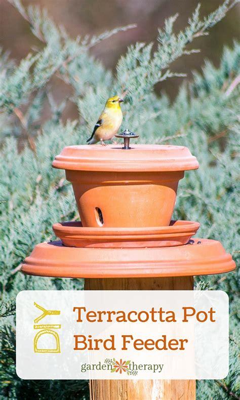put backyard birds on a pedestal with this flowerpot bird