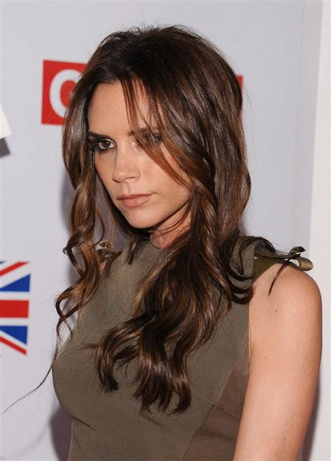 hottest loose hairstyles victoria beckham sexy center part brunette hairstyle with