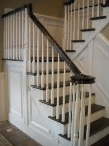 wood stairs and rails and iron balusters stairway