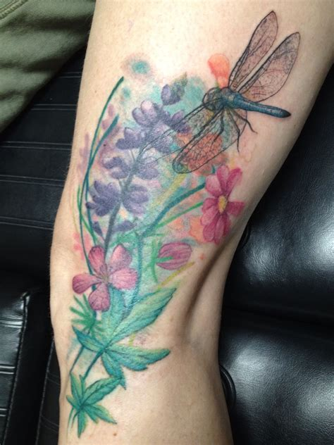 bamboo tattoo flowers with dragonfly done by