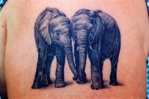 elephant couple tattoo 35 meaningful elephant designs will you