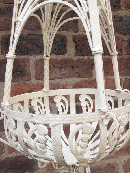 pair  cream metal hanging baskets