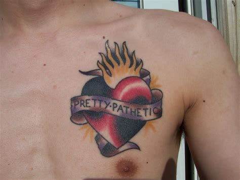 tattoo burning banner and burning on chest