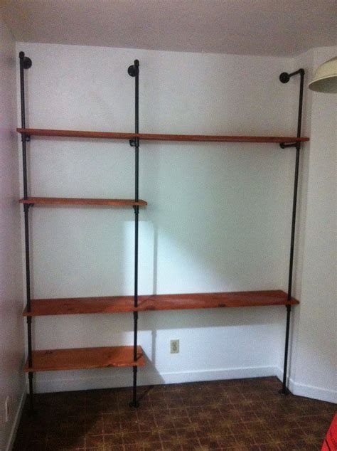 plumbing pipe shelves how to build a plumbing pipe shelving wall unit easy diy removeandreplace