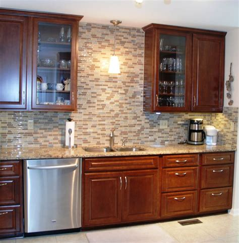 full wall kitchen cabinets ceiling height maple raised panel cabinets glass front