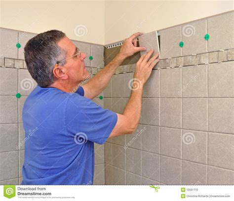 installing ceramic tile in bathroom stock photography
