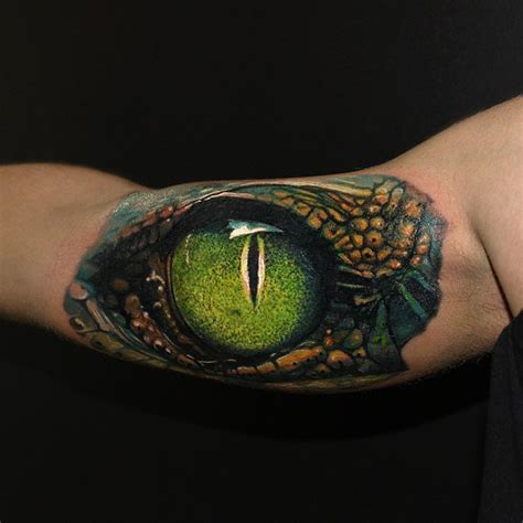 upper sleeve brilliant 3d realistic snake eye tattoo