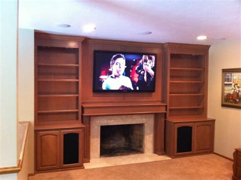 tv a fireplace with a great built in customer cabinet