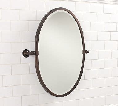 oval pivot bathroom mirror sussex pivot mirror oval antique bronzel finish traditional bathroom mirrors by pottery barn