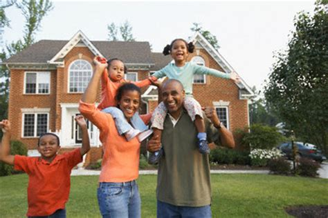 Family In Front Of House by Tips To Improve Your Home S Security Lakeside Collection