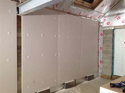 insulating a garage wall how best to do this