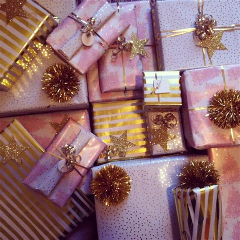 pretty gifts gold and pink christmas wrapping with stripes and dots and