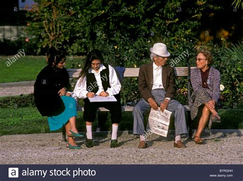 park bench people people sitting on a park bench 28 images girl sitting on park bench by urbazon