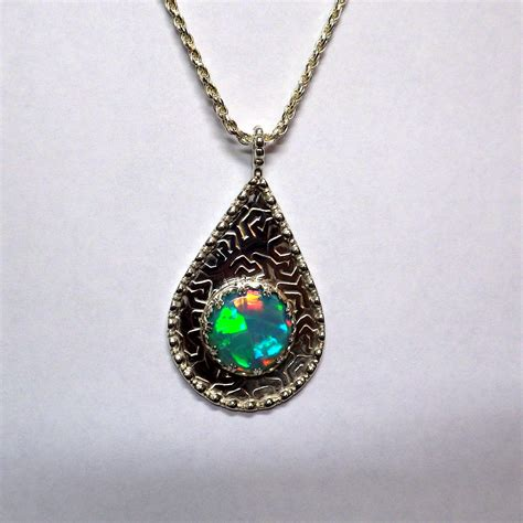 Handmade Opal Jewelry - handmade opal gold and silver jewelry by jacksopalsupply