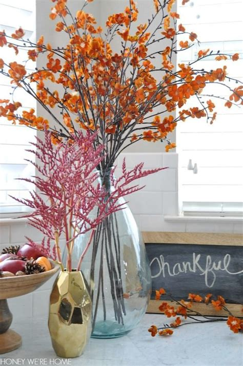 fall branches for decorations mixing faux and real flowering branches in fall decor