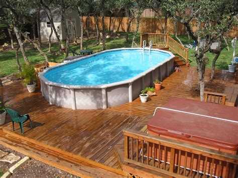 backyard pools above ground gardens arranging plants patio stones furniture