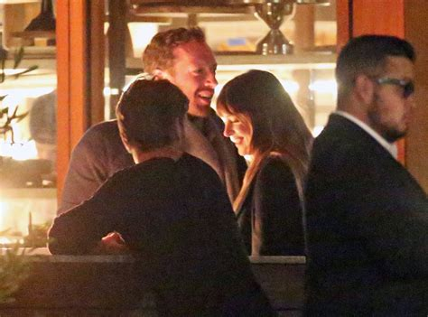 chris martin and chris martin and dakota johnson hold during date