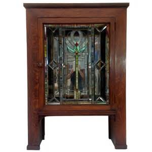 antique craftsman mission cabinet with stained glass door