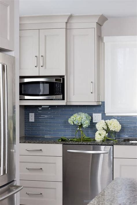 blue and white tile backsplash white kitchen cabinets with blue glass backsplash
