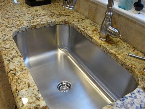 seamless sink in granite kitchen setting large single bowl