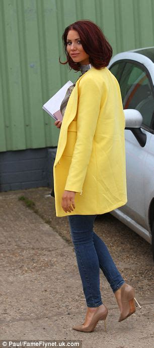 Working Wardrobe Uk by Childs Shines In A Yellow Coat As She On
