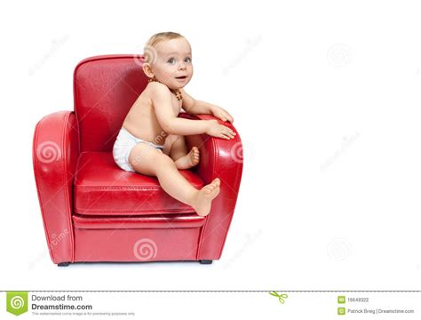 baby girl on an armchair stock photography image 16649322