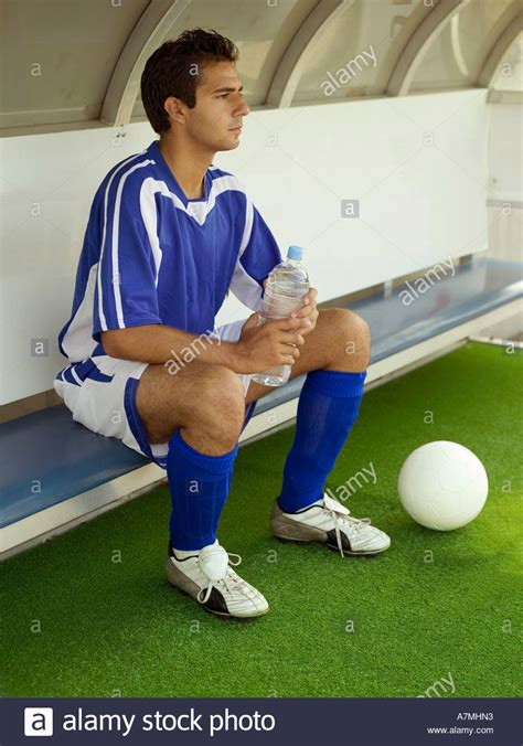 soccer player bench a soccer player sitting on the bench stock photo royalty