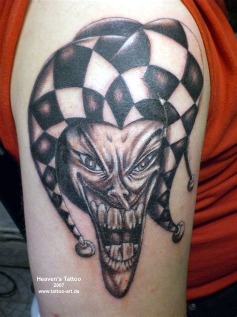 joker tattoo on arm upper arm joker tattoo for men tattoos book 65 000