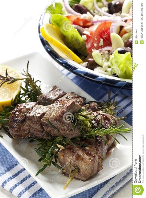 lamb kebabs and greek salad lamb kebabs with greek salad royalty free stock image