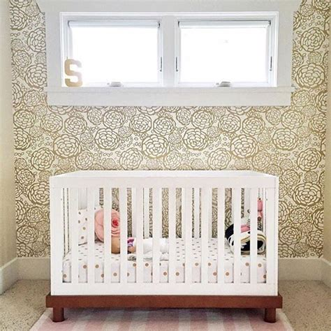 gold wallpaper nursery we can t get enough of this sweet little nursery and