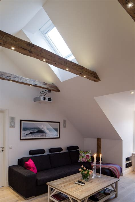 elegant small  bedroom modern attic apartment  exposed wood beams idesignarch