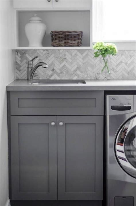 gray distressed kitchen cabinets with marble herringbone cool gray cabinets paired with a marble herringbone
