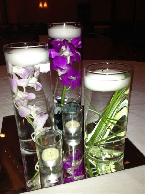 purple water centerpieces my purple orchids center with grass loved it