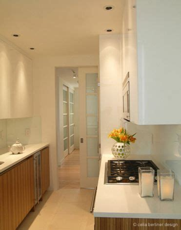 lacquered coffee color modern kitchen tall pantry cabinet high gloss white lacquer cabinets contrast with zebra wood