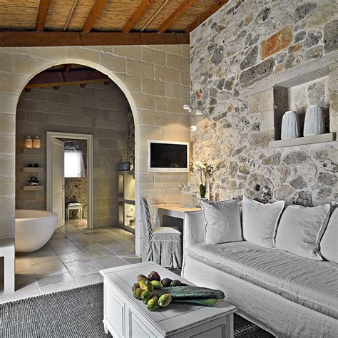 restored ancient stone house transformed  chic hotel
